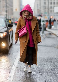 Browse the best street style looks from NYFW Fall 2017 via @STYLECASTER | tan coat over bright pink