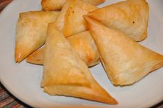 Delicious packets of crisp phyllo pastry wrapped around a savory cheese filling. Enjoy these Greek Phyllo Cheese Triangles at your next gathering.