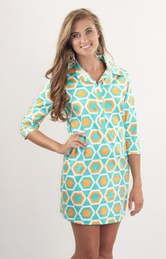 93a881bb4f1 Great knit Karlie dress in a fun geometric print. The neckline has button  snap closures