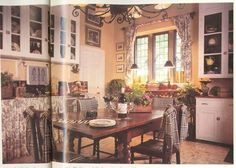 this photo inspired my French styled kitchen, including making the french print curtains myself.