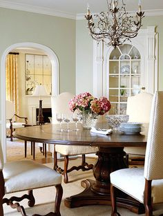 beautiful dining room/ love the wall color/ connect living and dining rooms with color