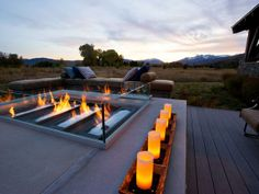 Series of candles would look great on the perimeter of the hottub.  Love the tray they sit in.