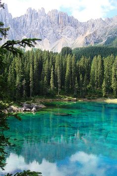 South Tyrol, Italy.  The water is so clear, and the trees are so thick you could get lost in seconds within its borders... but the most stunning part is the mountains in the background.