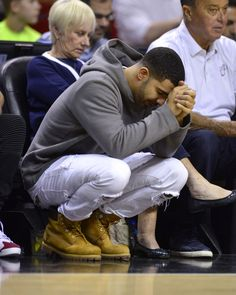 In honor of National Basketball Day, I've elected Drake to show you how watching a game is really done
