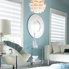 Cool and comfortable this room has soft lighting from its transitional window shades