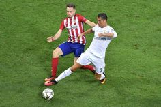 Atletico Madrid's Spanish midfielder Saul Niguez vies for the ball against Real Madrid's Portuguese forward Cristiano Ronaldo during the UEFA Champions League final football match between Real Madrid and Atletico Madrid at San Siro Stadium in Milan, on May 28, 2016.