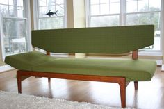 I would LOVE this sofa for my atomic ranch living-room. Vintage Arne Hovmand-Olsen sofa-daybed currently selling for $1500 on etsy.com.