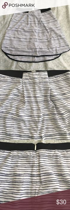 Armani Exchange skirt Perfect condition! 100% polyester combo. -00% polyester lining. 100% polyester. Armani Exchange Skirts High Low