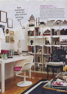 Ikea bookcase room divider with stuff on top