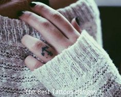 ring finger is the first choice to get the tattoos done anchor tattoo looking awesome