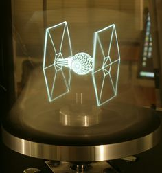 Researchers at the University of Southern California's ICT Graphics Lab have created a new type of holographic display that can generate simultaneous 3D views for multiple observers without the need for special glasses. The setup also happens to be relatively inexpensive since it's built around a specially modified off-the-shelf DLP projector that works with a spinning mirror.  STAR WARS IS REAL! LOL