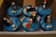 Fun with fondant!  Adorable penguin cupcakes...