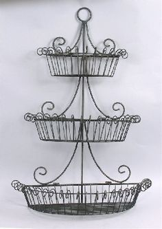 Hang on kitchen wall for fruit storage. Scrolled Wire Wall-Mount Basket in Black Finish- would be great since we eat lots of avocados, tomatoes, bananas and apples/oranges Or use in bathroom to hold guest towels and soaps Wire Wall Basket, Wire Fruit Basket, Wire Baskets, Baskets On Wall, Fruits Basket, Decorating Your Home, Interior Decorating, Decorating Ideas, Decor Ideas