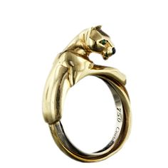 Estate Cartier panther ring - gold with emerald eyes and an onyx nose. From the Lang Antiques archives.