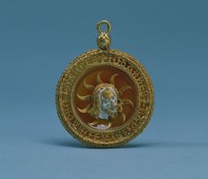 Pendant 15th century   French Pendant or Hat Pin with Head of John the Baptist .