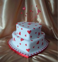 - This was made for a friend of my moms for her 40th Wedding Anniversary. Fondant coated strawberry sponge, with fondant coated inlaid board & gum paste hearts on wires.