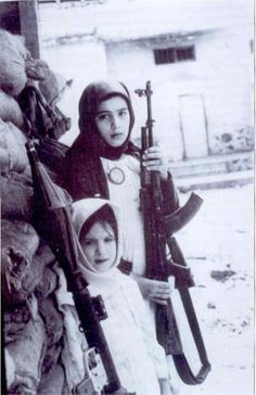 Two little girls soldier during the Lebanese civil war.