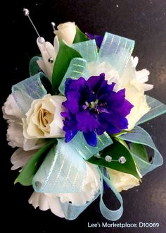 One of the beautiful custom dance or wedding wristlets designed by Lee's Corner Floral. Learn more or order yours today at leesmarketplacefloral.com