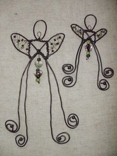 Metalwork and bead crafted angels.  I would fix it so they would hang.