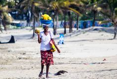 "The fruitlady - ""The Fruitlady"", walking the beach of Cabarete, Dominican Republic, trying to earn a living."