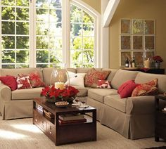 Pottery Barn Living Room, great example of a neutral room that can be transformed with a few pillows and accessories as desired. I'd like a fabulous coffee table to go with this sofa.
