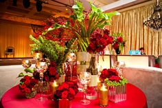 Lilies and Roses #YourEventFlorist #RedWedding #LavishWedding #TheGoldStandard      Flowers by Your Event Florist. Photography by LightRain Images.