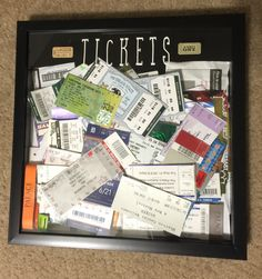 Tickets display: I bought a shadow box and cut a slit in the top (about 3 inches long by .25 inch wide), and then used stickers on the front of the glass for the word 'TICKETS'. Now when i go to something memorable, i just drop the ticket in from the top like a piggy bank, and watch it fill up! it's evolving wall art :)