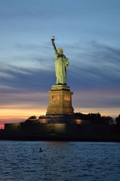 Statue of Liberty at night. Vote for your favorite travel photo of the year: https://www.facebook.com/ViatorTours/app_603986049642943