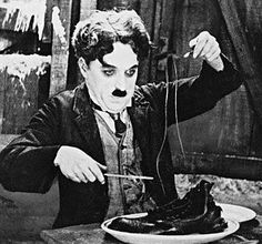 The Paper Sandwich: Charlie Chaplin is Eating His Shoes. Clothing becomes food as Charlie Chaplin is forced to eat his leather shoes in The Gold Rush.