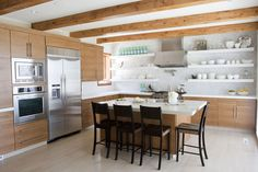 Open Shelving, Tile to the ceiling, Caesar Stone counters. Nemrow Kitchen by Alice Lane