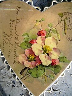 Old postcard cut into a heart.