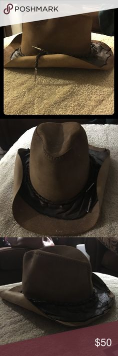 Vintage leather cowboy hat Really cool vintage tan and dark brown leather cowboy hat. I picked this up at an antique store in Aspen, CO several years ago and have never worn it. It is a little dusty but has no flaws or damage- just too lazy to clean it :/ head n home Accessories Hats