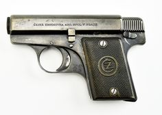 CZ Ceska Zbrojovka 1922 6.35mm caliber pistol. Rare Czech .25 auto pistol designed by Alois Tomiska in 1922 and was derived from an earlier Tomiska designed fox pistol in 1918. These were the first CZ pistols to carry the CZ trademark. Gun has approximately 95% blue. Bore is worn. Action works perfectly. (Magazine is probably a replacement but fits the gun well.) Very rare Czech auto.