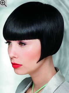 Very short bob with a shiny surface and a fringe with sharp cutting lines. 1920s inspired.