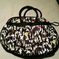 LeSportsac  (nwot ) There are exterior pockets the length of the back on the front and back. The bag is expandable. The interior is solid black with multiple pockets and zipper compartments . There us a zippered closure to keep your belongings secure LeSportsac  Bags Totes