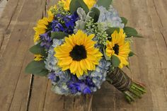 Blue and Yellow bridal bouquet with sunflowers,hydrangea,delphinium,seeded eucalyptus,dusty miller