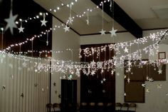 If you can't hang individual stars from the ceiling, hanging from string lights is easier and makes for faster clean up but is still just as cute.