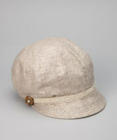 ecdaa382869 Take a look at this Tickled Pink Beige Medallion Jockey Cap by Tickled Pink  on