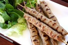 Nem Nướng. Also, other recipes: http://wanderingchopsticks.blogspot.ca/2007/04/nem-nuong-and-nem-nuong-cuon-vietnamese.html and http://www.theravenouscouple.com/2009/05/nem-nuong-cuon-spring-rolls-with-grilled-pork-patties.html