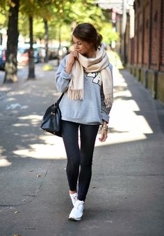 Marianna N. is wearing a grey sweater from Project Social T, jeans from TopShop, sneakers from Reebok, bag from Saint Laurent and the scarf is from Acne Studios