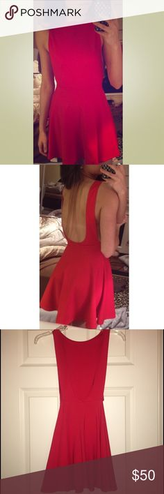 Red Skater Dress American Apparel skater dress! Open back and open sides, very sexy! Wore once, in perfect condition! Perfect date night dress! Size medium, however, runs small! I'm normally an xs/s! American Apparel Dresses Backless