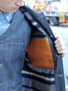 Denim vest, pants, jacket with leather interior detail.