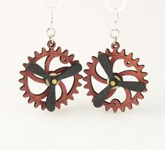 """Made in U.S.A Style # 5006D Size 1.65"""" x 1.5"""" Kinetic Gear Earring 5006D All Gears Move! Comes as shown - Cherry Red/Black Satin Made from sustainably sourced materials Laser-cut wood Stained with water based dye Ear wires are silver-finished 3041 stainless steel with new electrophoretic-coating that resists tarnishing"""