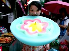 Videos of Chinese street vendors selling elaborate, beautifully constructed cotton candy flowers have us reevaluating the monochromatic fluff of our childhood.