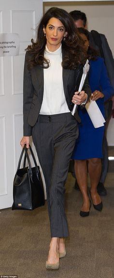 Amal Clooney attends a press conference at Doughty Street Chambers on October 5, 2015 in London