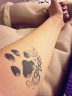 "Dog Paw Tattoo in memory of my dog ""Pixie"" - Fairy wings by her name This is her exact paw print so it's not perfectly symetrical"