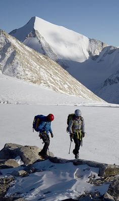 Nepal's unexplored mountains: Jones and Arnot being chased by shadows on Mansail Peak, after encountering a technical rock route to the summit. #LiveYourAdventure