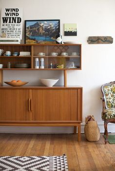 I have the mid-century sideboard, the china, etc...now I just need to organize so it looks more like this and less like an episode of 'Hoarders'