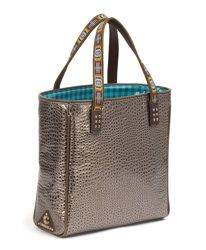 The Gator Tote's exterior is a sophisticated metallic alligator embossed material. The chic exterior is contrasted with black and blue gingham material, which wipes clean easily.