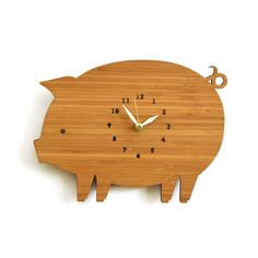 """This sweet piggy wall clock features round body, a pointy ear and a curly tail. Product Specifications  • Size: 10"""" wide x 8"""" tall  • 100% Eco-friendly!"""